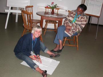 des bénévoles se préparent à accueillir des pèlerins à la Cité Saint-Pierre à Lourdes